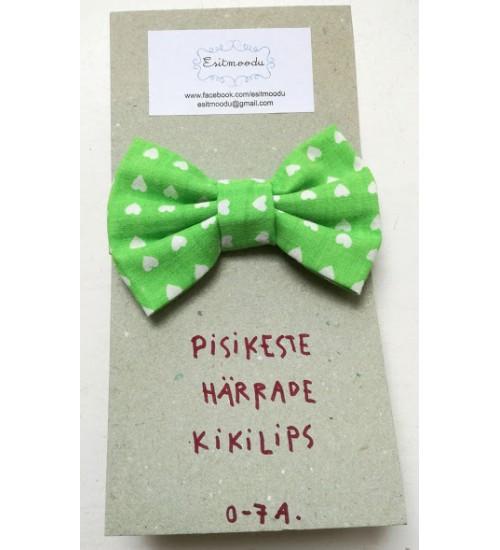 Pisikese härra kikilips - valged südamed rohelisel taustal