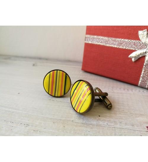 Muhu kollase triibulised mansetinööbid