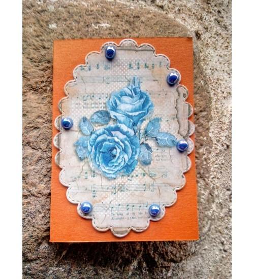 Pisike õnnitluskaart helesiniste roosidega